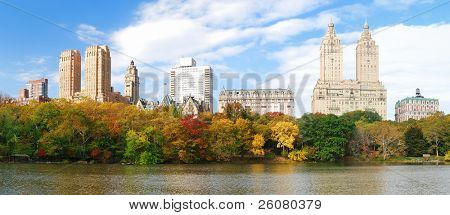 New York City Manhattan Central Park panorama in Autumn lake with skyscrapers and colorful trees over with reflection.