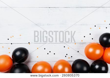 Black And Orange Balloons And Confetti For Halloween Card Or Invitation. Flat Lay.
