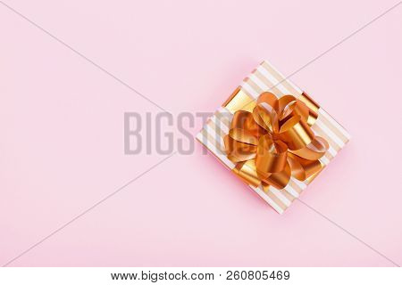 Gift Or Present Box On Pink Table Top View. Flat Lay Composition For Birthday, Christmas Or Wedding.