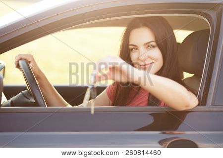 Automobile Owner Holds Key, Sits At Drivers Seat, Keeps Hand On Wheel, Advertises Or Sells Car. Beau