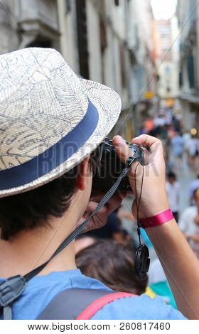 Young Photographer With Hat Takes Some Picutres Of Venice In Italy