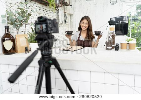 Attractive Young Asian Beautiful Caucasian Barista In Apron Smiling With Recording Video Camera Film