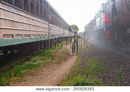 Kaliningrad Russia September 16, 2018, Cyclist Between Two Trains, Cyclist On Railway Tracks