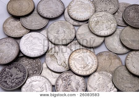 Close up of silver dollars in a pile