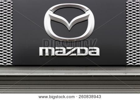 Macon, France - May 27, 2018: Mazda Logo On A Facade. Mazda Is A Japanese Automaker Based In Fuchu,