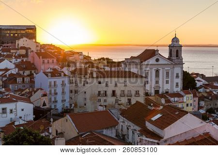 The City Of Lisbon Is Located In Front Of The Ocean. Its Picturesque Neighborhoods, Alfama, Bairro A