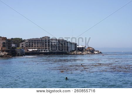 This Is An Image Of The Monterey Bay Waterfront Taken From A Near By Pier Taken On A Clear Sunny Day