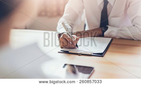 Businessman Writing Form Submit Resume Employer To Review Job Application. Concept Presents Ability