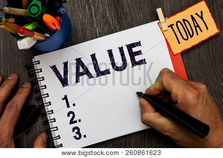 Handwriting text Value. Concept meaning principles or standards behaviour judgement what important in life Man holding marker notebook clothespin hold reminder cup markers wood table. poster