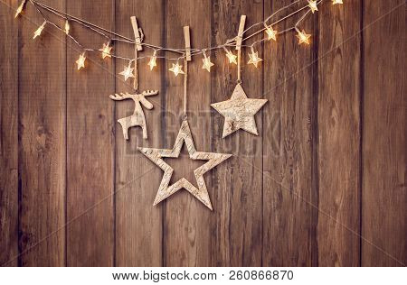 Rustic Christmas Decorations And String Lights On A Wood Style Background