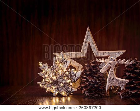Simple, Natural Christmas Decorations Including Pine Cones And Rustic Wooden Ornaments Wrapped In Li