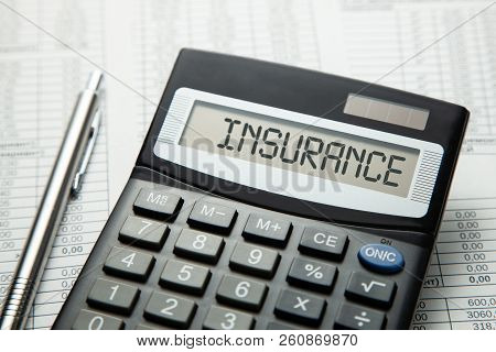 Сalculator With The Inscription On The Insurance Display On The Paper Tables. Concept Medical Insura