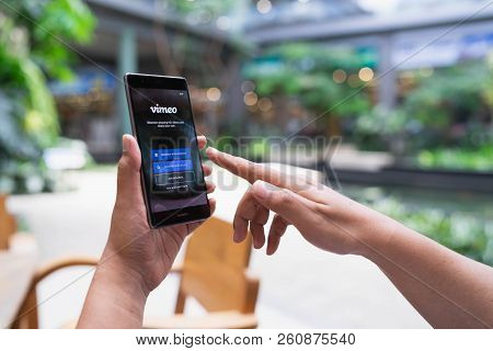 Chiang Mai, Thailand - May 05,2018: Man Holding Huawei With Vimeo On Screen.  Vimeo Is A Video-shari