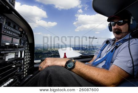 co-pilot flying small aircraft with clouds in background