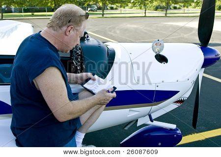 Private pilot logging trip and checking oil