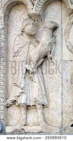 MODENA, ITALY - JUNE 04: Plate with stories from Genesis: Story about Abel and Cain, The sacrifice of Cain and Abel, relief by Wiligelmo, Modena Cathedral, Italy on June 04, 2017.