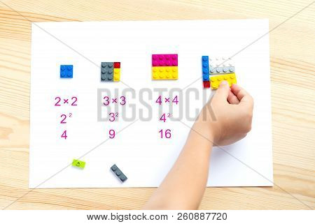 The Child Puts The Colored Blocks In The Right Place. Math Games For Children. Mathematics, Logic, T
