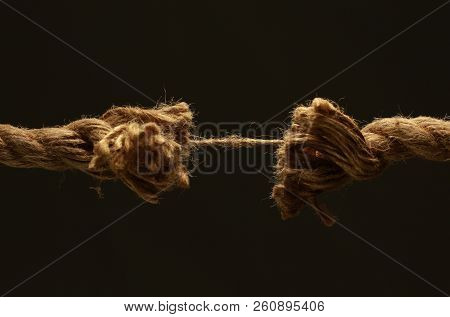 Closeup.old Frayed Rope .isolated On A Black Background.