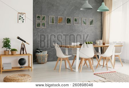 Modern, White Dining Chairs Around A Large Wooden Table In A Botanic Dining And Living Room Interior