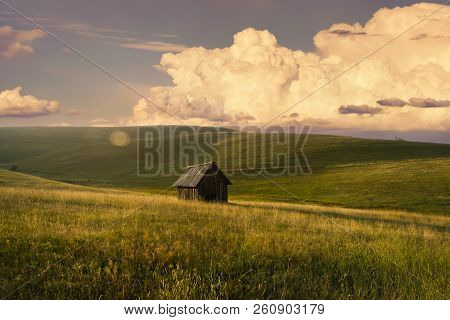 Sunset In Countryside Landscape. Fields And Countryside Landscape. Old Cabin In Nature In Sunset. Na