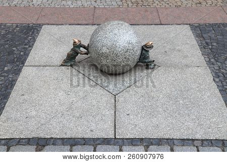 Wroclaw, Poland - May 11, 2018: Sisyphus Gnomes Of Dwarves Small Statues In Wroclaw, Poland. Wroclaw