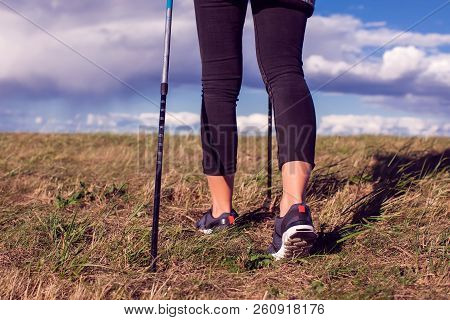 Nordic Walking, Exercise, Adventure, Hiking Concept -a Woman Hiking In The Nature