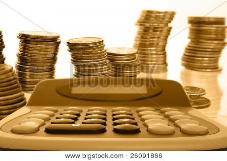Gold coins and calculator.