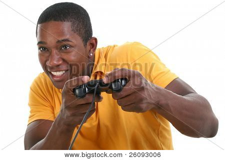 Close up young black man with excited expression playing video game with controller over white.