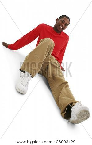 Casual Young Man in Khakis and Long Sleeve Red Shirt. Shot in studio over white.