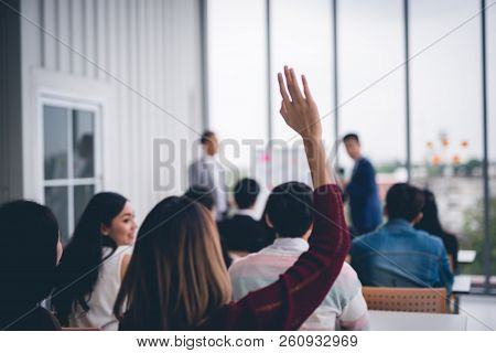 Woman Raised Up Hands And Arms  In Seminar Class Room To Agree With Speaker At Conference Seminar Me