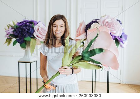 Floral Design Concept. Beautiful Satisfied Female Florist Makes Composition Of Beautiful Artificial