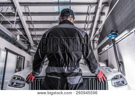 Car Mechanic Challenge. Caucasian Auto Service Worker Preparing For Challenging Work To Fix Broken V