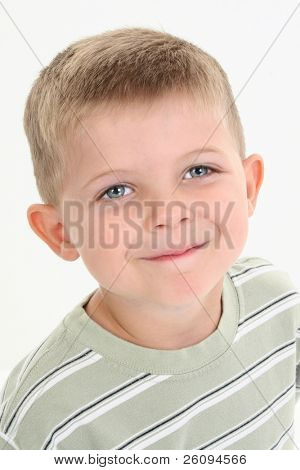Close-up of an adorable four year old boy in casual clothing. Shot in studio over white.