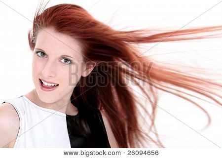 Headshot of a beautiful young woman with long red hair and hazel eyes.