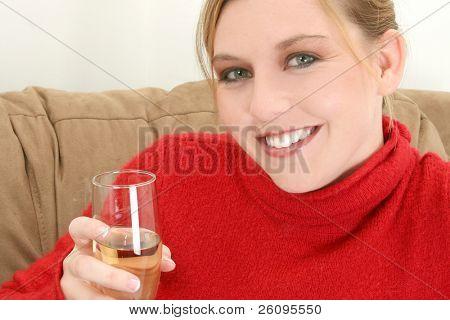 Beautiful young woman with glass of champange.