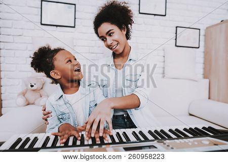 Happy Day For Mother And Happy Day For Young Girl. Mother Help Young Girl With Piano. Smile Young An