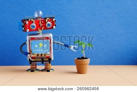 Smiley Robot With A Small Green Sprout Plant In A Clay Flower Pot. Organic Eco Life Concept. Blue Wa
