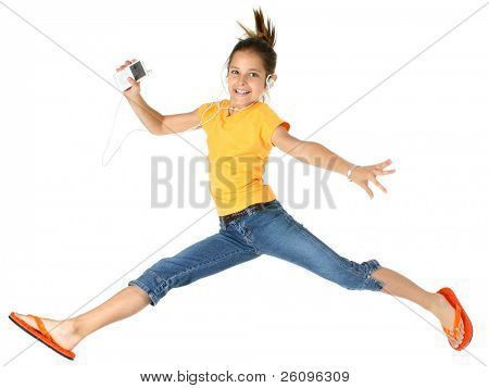Happy girl jumping and listening to music.