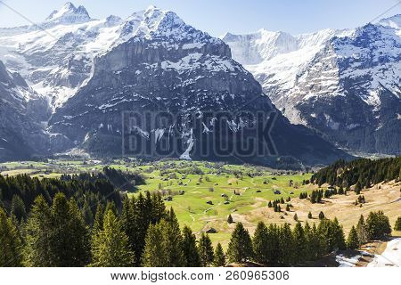 Houses In Small Village And Hotels On Mountain Alps At Grindelwald First Peak Switzerland Europe