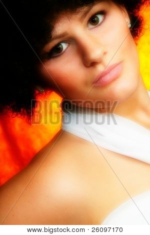 Beautiful nineteen year old girl with white dress, black hair.