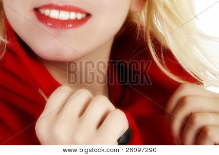 Close up of woman's lips smiling.