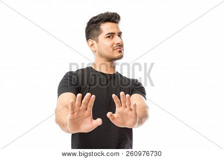 Handsome Young Man Expressing Denying On White Studio Background
