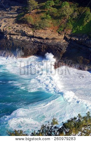 Waves Rush In To The Shoreline Of Kilauea Point Wildlife Sanctuary On The Island Of Kauai.  White Do