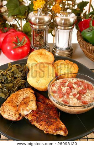 Cajun flavored catfish and chicken with red beans, turnip greens and jalepeno cornbread.