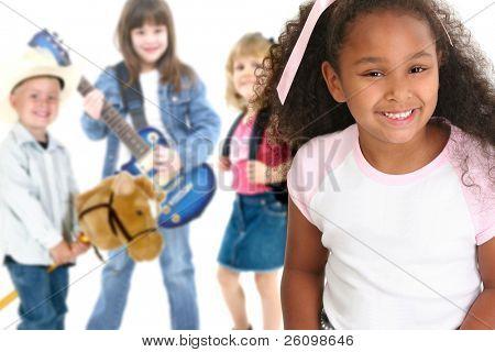 Children over white.  Kindergarten, first grade, second grade, third grade.