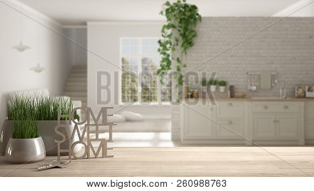 Wooden Table, Desk Or Shelf With Potted Grass Plant, House Keys And 3d Letters Making The Words Home