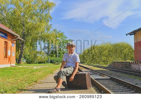Little Boy  On A Railway Station, Waiting For The Train With Vintage Suitcase. Traveling, Holiday An