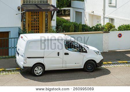 Paris, France - Aug 10, 2018: White Nissan Electric Van Parked On The Street Distributing Parcels Fr