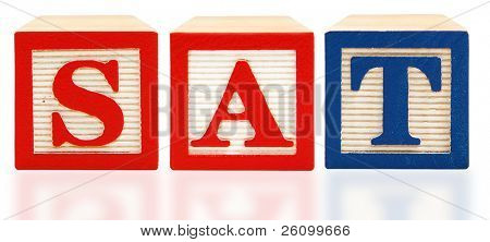 Scholastic Assessment Test SAT alphabet blocks over white background.