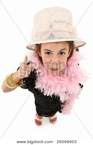 Adorable zes jaar oude Frans american girl verkleed in mama's jurk en hoed op witte achtergrond.